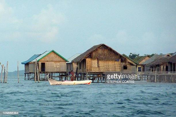 EnvironmentIndonesiaclimateoceansreefs FEATURE by Stephen CoatesIn this photograph taken January 28 2011 fishermens' houses stand on stilts at a Bojo...