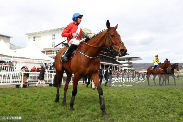 Envoi Allen ridden by Davy Russell after winning the Ballymore Novices' Hurdle at Cheltenham Racecourse on March 11 2020 in Cheltenham England