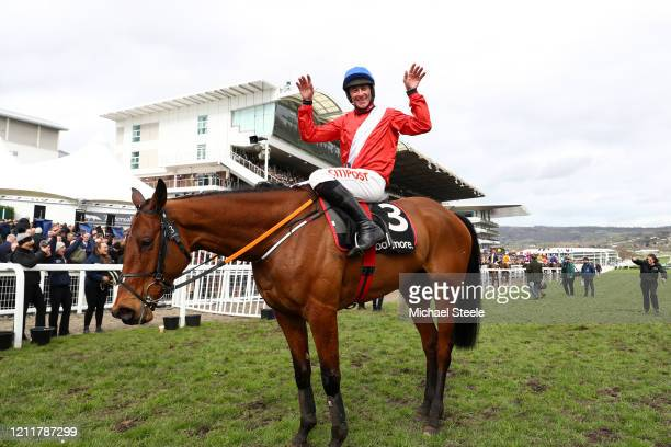Envoi Allen ridden by Davy Russell celebrates after winning Ballymore Novices' Hurdle at Cheltenham Racecourse on March 11 2020 in Cheltenham England