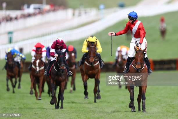 Envoi Allen ridden by Davy Russell celebrates after winning the Ballymore Novices' Hurdle at Cheltenham Racecourse on March 11 2020 in Cheltenham...