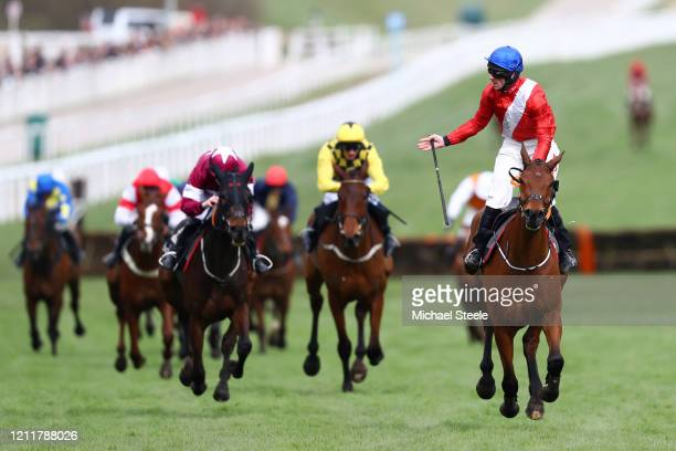 Envoi Allen ridden by Davy Russell celebrates winning the Ballymore Novices' Hurdle at Cheltenham Racecourse on March 11 2020 in Cheltenham England