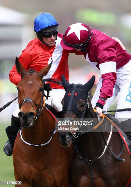 Envoi Allen ridden by Davy Russell celebrates with Rachael Blackmore after winning the Ballymore Novices' Hurdle at Cheltenham Racecourse on March 11...