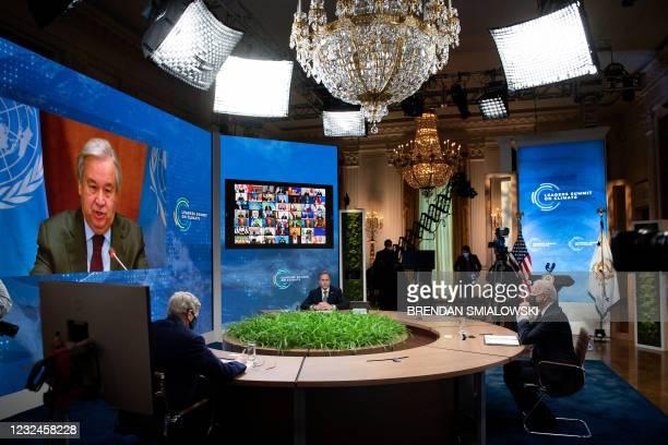 Envoy for climate John Kerry, US Secretary of State Antony Blinken, and US President Joe Biden listen as United Nations Secretary General Antonio...