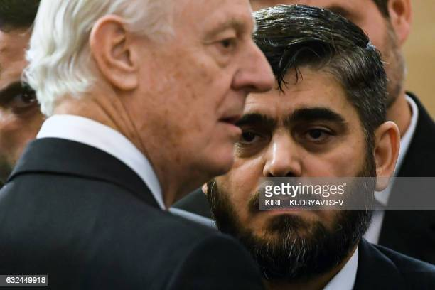 UN envoy for Syria Staffan de Mistura speaks with chief opposition negotiator Mohammad Alloush of the Jaish alIslam rebel group prior to the first...