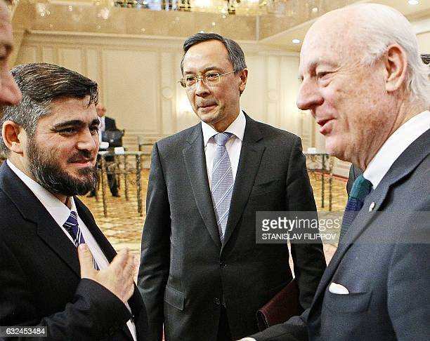 UN envoy for Syria Staffan de Mistura speaks with chief opposition negotiator Mohammad Alloush of the Jaish alIslam rebel group as Kazakh Foreign...