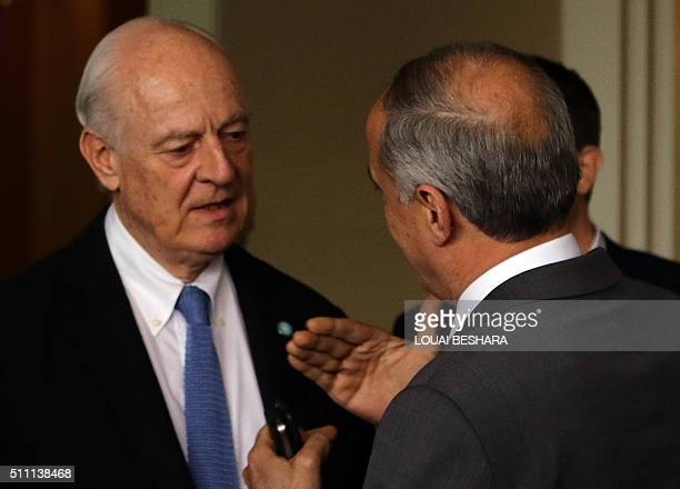 UN envoy for Syria Staffan de Mistura speaks with Syria's assistant Foreign Minister Ayman Sosan as he leaves at his hotel in the Syrian capital...