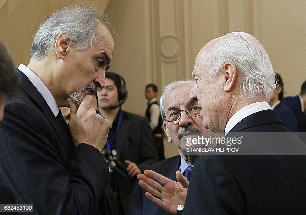 UN envoy for Syria Staffan de Mistura speaks with Syria's UN ambassador and head of the government delegation Bashar alJaafari prior to the first...
