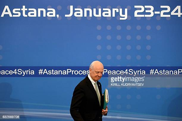 UN envoy for Syria Staffan de Mistura walks to take his seat before the announcement of a final statement following Syria peace talks in Astana on...