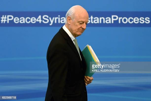 TOPSHOT UN envoy for Syria Staffan de Mistura walks to take his seat before the announcement of a final statement following Syria peace talks in...