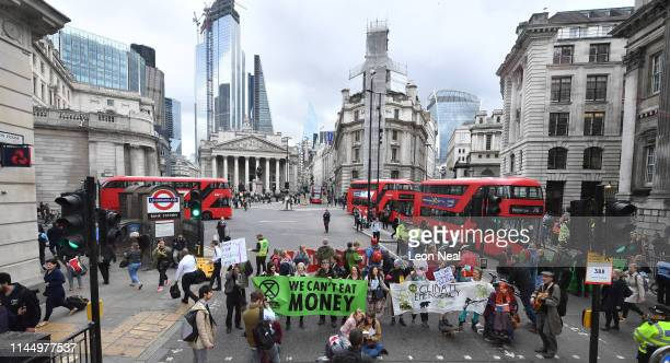 Envrionmental campaigners from the Extinction Rebellion group block the junction at Bank as part of their ongoing actions and protests across the...