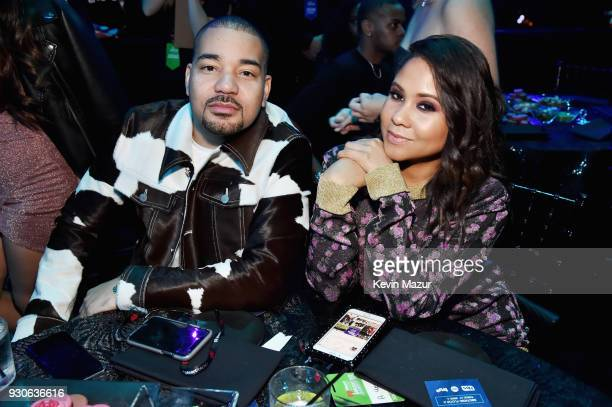 Envy and Angela Yee attend the 2018 iHeartRadio Music Awards which broadcasted live on TBS TNT and truTV at The Forum on March 11 2018 in Inglewood...