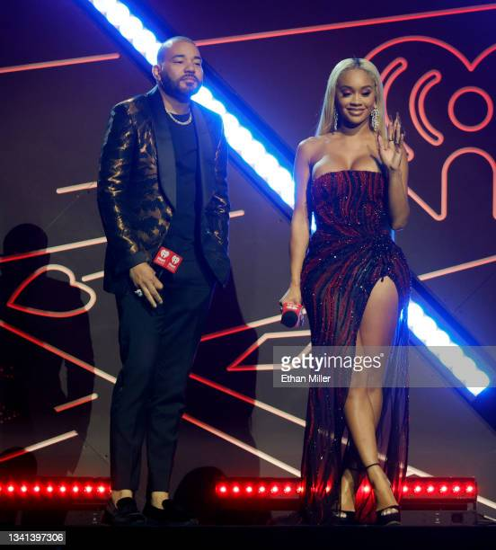 Envy and Saweetie introduce a performance by Lil Baby during the 2021 iHeartRadio Music Festival at T-Mobile Arena on September 18, 2021 in Las...