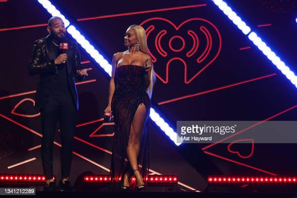 Envy and Saweetie speak onstage during the 2021 iHeartRadio Music Festival at T-Mobile Arena on September 18, 2021 in Las Vegas, Nevada.