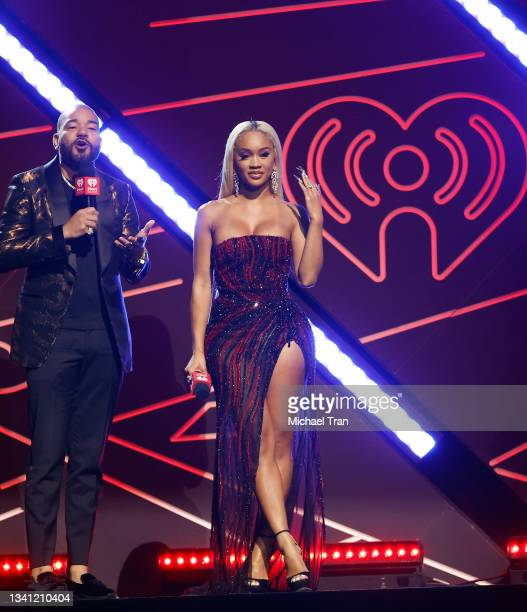 Envy and Saweetie speak onstage during the 2021 iHeartRadio Music Festival - Night Two held at T-Mobile Arena on September 18, 2021 in Las Vegas,...