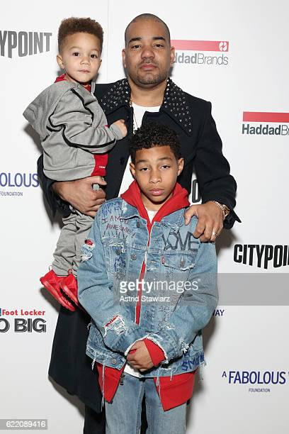 Envy poses with his children during BKLYN Rocks presented by City Point Kids Foot Locker and Haddad Brands at City Point on November 9 2016 in...
