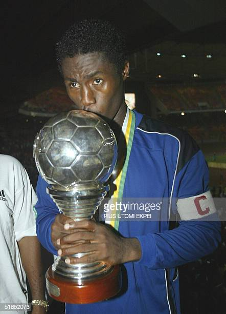 Enyimba's captain Obinna Nwaneri kisses the CAF Cup 12 December 2004 won in Abuja National Stadium Enyimba defeated Etoille d' Sahel of Tunisia on...