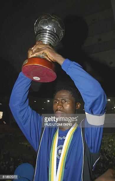 Enyimba's captain Obinna Nwaneri raises the CAF Cup 12 December 2004 won in Abuja National Stadium Enyimba defeated Etoille d' Sahel of Tunisia on...
