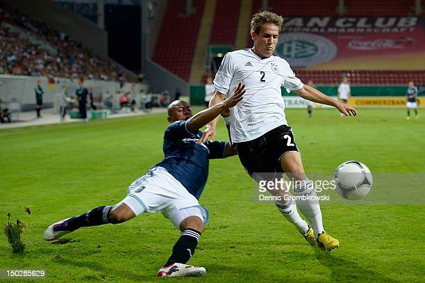 Enzo Beloso of Argentina challenges Oliver Sorg of Germany during the Under 21 international friendly match between Germany U21 and Argentina U21 at...