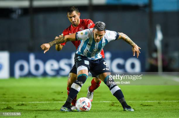 Enzo Copetti of Racing Club fights for the ball with Lucas Rodriguez of Independiente during a match between Racing Club and Independiente as part...