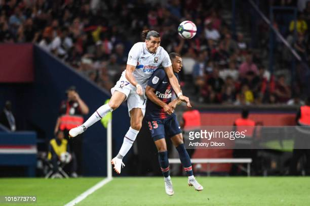 Enzo Crivelli of Caen and Antoine Bernede of PSG during the French Ligue 1 match between Paris Saint Germain and Caen at Parc des Princes on August...