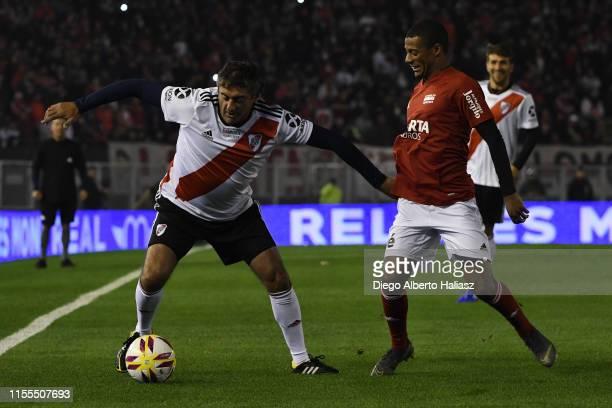 Enzo Francescoli and Nicolas De la Cruz fight for the ball during the farewell match of Uruguayan player Rodrigo Mora at Estadio Monumental Antonio...