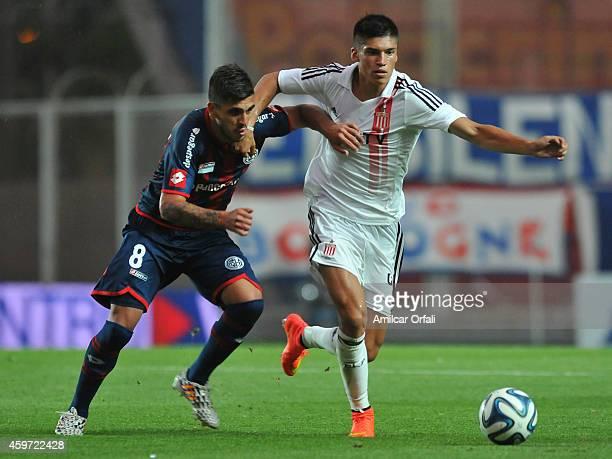 Enzo Kalinski of San Lorenzo and Joaquin Correa of Estudiantes struggle for the ball during a match between San Lorenzo and Estudiantes as part of...