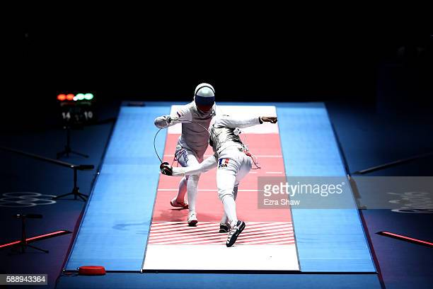 Enzo Lefort of France competes against Artur Akhmatkhuzin of Russia during the Men's Foil Team Gold Medal Match bout on Day 7 of the Rio 2016 Olympic...