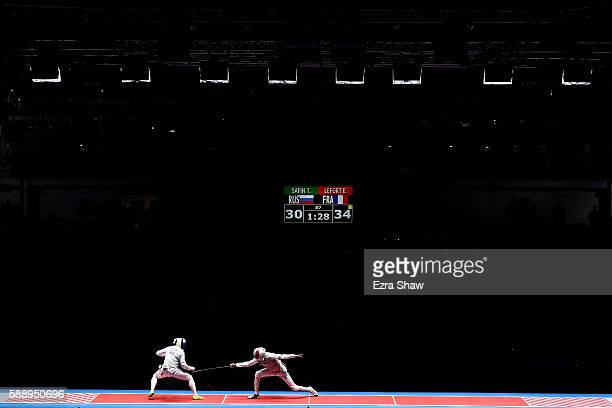 Enzo Lefort of France competes against Timur Safin of Russia during the Men's Foil Team Gold Medal Match bout on Day 7 of the Rio 2016 Olympic Games...