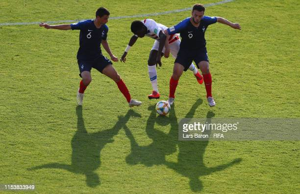 Enzo Loiodice and Amine Gouiri of France challenge Timothy Weah of USA during the 2019 FIFA U20 World Cup Round of 16 match between France and USA at...