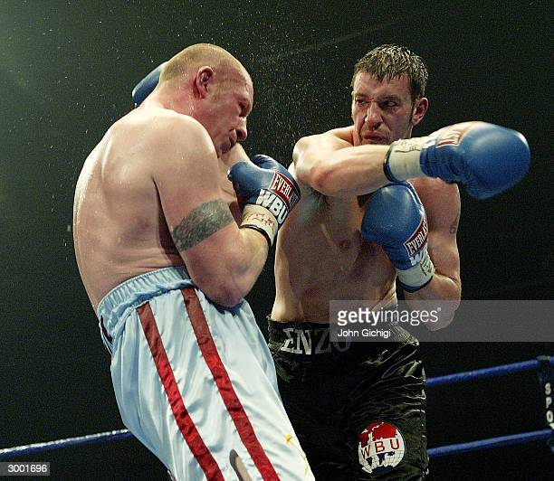 Enzo Maccarinelli of Wales and Gary Delaney of England in the cruiserweight contest at Cardiff Ice Rink on February 21 2004 in Cardiff Wales