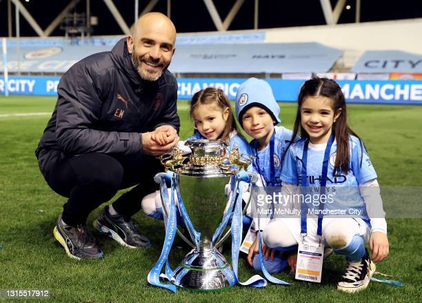Enzo Maresca, manager of Manchester City poses with his children and the trophy during the Premier League 2 match between Manchester City and...
