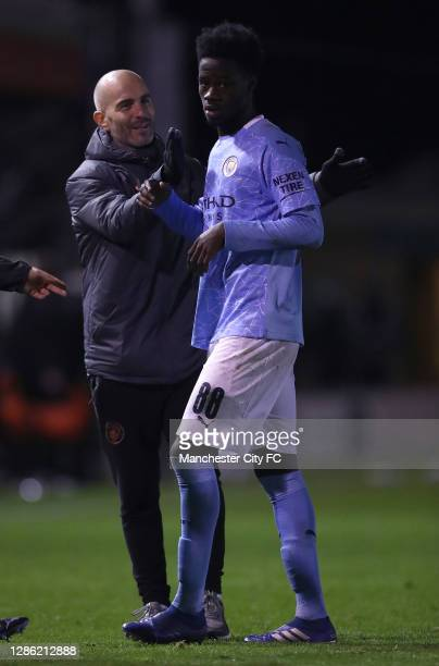 Enzo Maresca, manager of Manchester City U21 consoles Darko Gyabi of Manchester City U21, after losing on penalties during the EFL Trophy match...