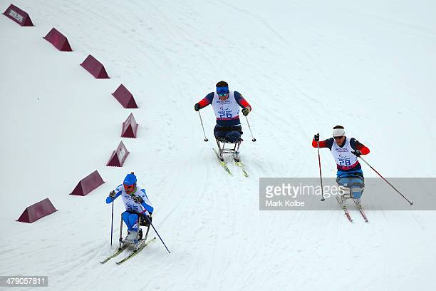 Enzo Masiello of Italy Irek Zaripov of Russia and Roman Petushkov of Russia compete in the Men's Cross Country10km Sitting on day nine of the Sochi...