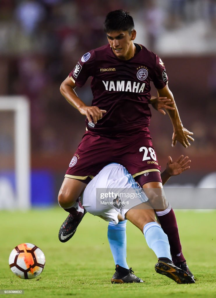 Enzo Ortiz of Lanus fights for the ball with Alexis Rojas of Sporting Cristal during a first leg match between Lanus and Sporting Cristal as part of first round of Copa CONMEBOL Sudamericana 2018 at Ciudad de Lanus Stadium on February 21, 2018 in Lanus, Argentina.