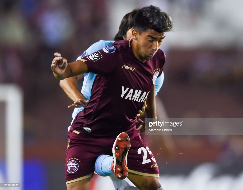 Enzo Ortiz of Lanus receives a kick during a first leg match between Lanus and Sporting Cristal as part of first round of Copa CONMEBOL Sudamericana 2018 at Ciudad de Lanus Stadium on February 21, 2018 in Lanus, Argentina.