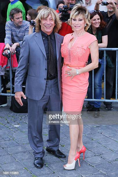 Enzo Paolo Turchi and Carmen Russo attend the Valeria Marini And Giovanni Cottone wedding at Ara Coeli on May 5 2013 in Rome Italy