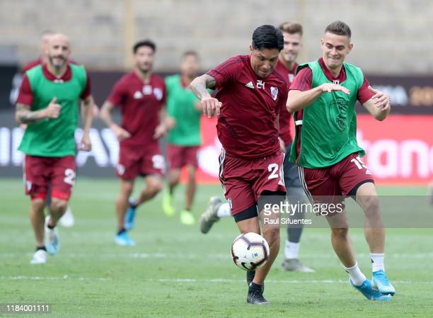 Enzo Perez and Rafael Borre fight for the ball during a training session on the day before the Copa Libertadores 2019 Final at Estadio Monumental on...