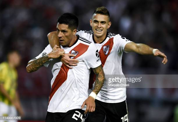 Enzo Perez of River Plate celebrates after scoring the first goal of his team with teammate Rafael Santos Borre during a first leg round of sixteen...