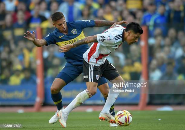 Enzo Perez of River Plate fights for the ball with Agustin Almendra of Boca Juniors during a match between Boca Juniors and River Plate as part of...