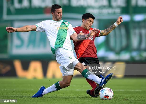 Enzo Perez of River Plate fights for the ball with Franco Quinteros of Banfield during a match between Banfield and River Plate as part of Copa de la...