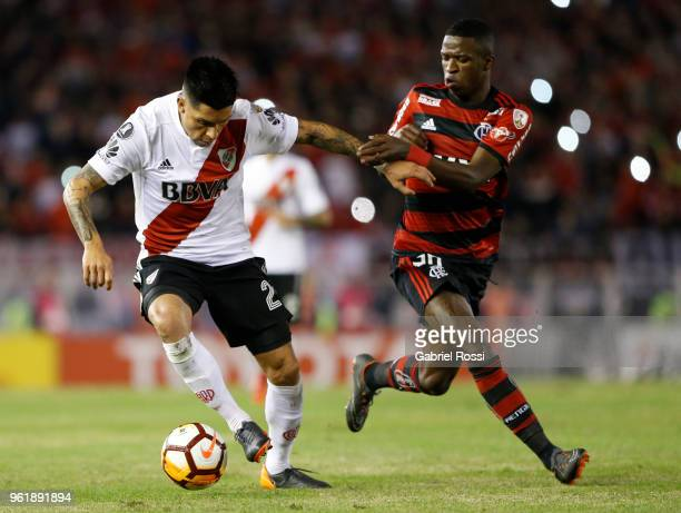 Enzo Perez of River Plate fights for the ball with Vinicius Junior of Flamengo during a match between River Plate and Flamengo as part of Copa...