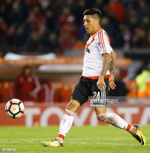 Enzo Perez of River Plate kicks the ball to score the eighth goal of his team during a second leg match between River Plate and Wilstermann as part...