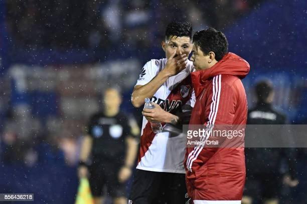 Enzo Perez of River Plate talks to Marcelo Gallardo head coach of River Plate during a match between Tigre and River Plate as part of Superliga...