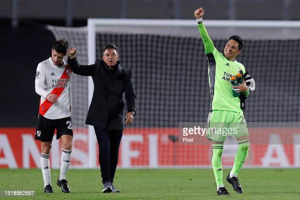 Enzo Pérez goalkeeper of River Plate and his coach Marcelo Gallardo celebrate after winning a match between River Plate and Independiente Santa Fe as...