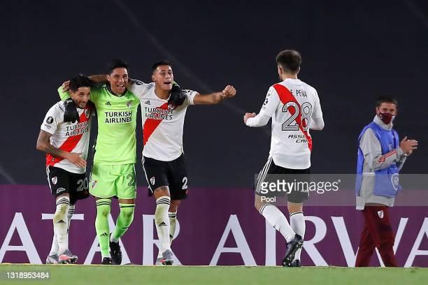 Enzo Pérez goalkeeper of River Plate celebrates with teammates Milton Casco, Tomás Lecanda and Felipe Peña Biafore after winning a match between...