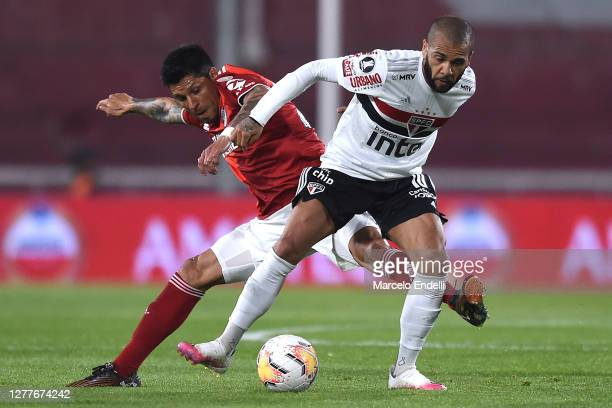 Enzo Pérez of River Plate competes for the ball with Dani Alves of Sao Paulo during a Copa CONMEBOL Libertadores 2020 group D match between River...