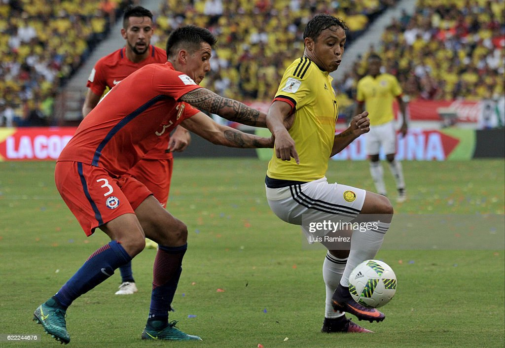 Enzo Roco of Chile fights for the ball with Luis Fernando Muriel of Colombia during a match between Colombia and Chile as part of FIFA 2018 World Cup Qualifiers at Metropolitano Roberto Melendez Stadium on November 10, 2016 in Barranquilla, Colombia.