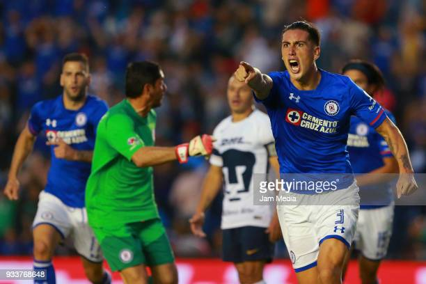 Enzo Roco of Cruz Azul celebrates after scoring the first goal of his team during the 12th round match between Cruz Azul and Pumas UNAM as part of...