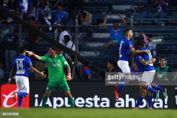 Enzo Roco of Cruz Azul celebrates after scoring the tying goal during the 12th round match between Cruz Azul and Pumas UNAM as part of the Torneo...