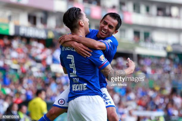 Enzo Roco of Cruz Azul celebrates with teammate Rafael Baca after scoring the first goal of his team during the 3rd round match between Leon and Cruz...